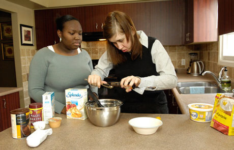 Two women baking in the kitchen