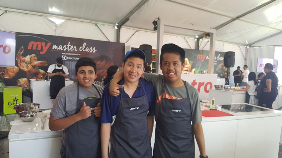 Young men at cooking station