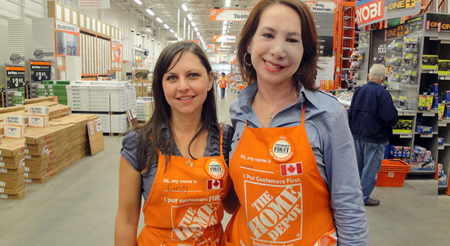 Two women working at Home Depot