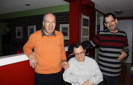 Three men in their home
