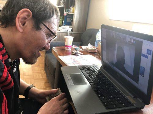 Gio on his laptop